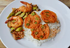 Fried fish cake and spicy stir fried twisted cluster bean with shrimp on rice Royalty Free Stock Photo