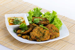 Fried fish cake on white disc Royalty Free Stock Images
