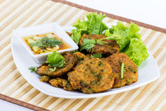 Fried fish cake on white disc Stock Photography