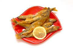Fried fish-capelin and lemon Stock Photography