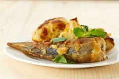 Fried fish with cauliflower Stock Photos