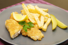 Fried fish and chips on the plate for dinner Stock Photography
