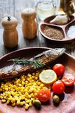 Fried fish with corn and vegetables Stock Photography
