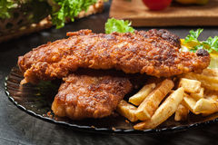 Fried fish in crispy batter with chips Stock Photography