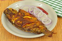 Fried fish decorated with onion rings