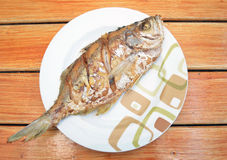 Fried fish on dish Stock Photo