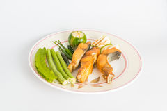 Fried fish on dish with vegetable Royalty Free Stock Photo