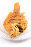 Fried fish. On dish isolated on white background Royalty Free Stock Photos