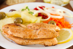 Fried fish eggs with vegetables Stock Photo