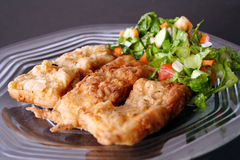 Fried fish filet in dish Stock Photo