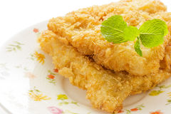 Fried fish fillet on dish. Stock Images