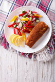 Fried fish fillet with fresh vegetables and a lemon. vertical to Royalty Free Stock Photos