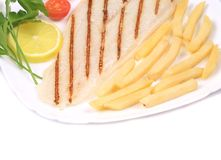 Fried fish fillet with fries and vegetables Royalty Free Stock Photography