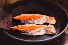 Fried fish fillet in a frying pan Stock Photo