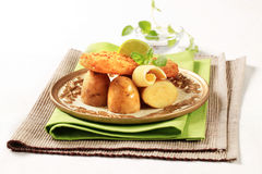 Fried fish fillet with new potatoes Stock Photos