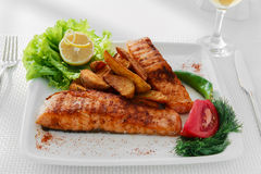 Fried fish fillet of salmon. With potatoes Stock Photos