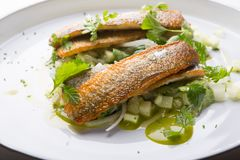 White fish grilled and served with vegetables Royalty Free Stock Image