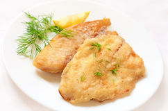 Fried fish fillet. On white plate Stock Photography