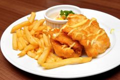 Fried fish fillets and french fries Royalty Free Stock Images