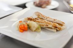 Fried fish fillets and vegetables Stock Photo