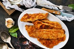 Fried fish fillets. On white plate, fried fish stock photos