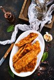 Fried fish fillets. On white plate, fried fish royalty free stock photography