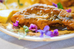 Fried fish with flowers Royalty Free Stock Images