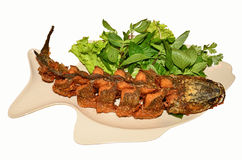 Fried fish food. Fried cut snake fish with vegetables Royalty Free Stock Photo