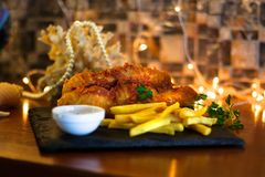 Fried Fish with French Fries & Dip Sauce royalty free stock photography