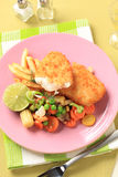 Fried fish with French fries and mixed vegetables Stock Photography