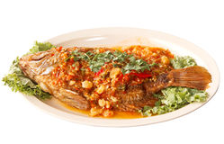 Fried fish with fresh herbs  sweet spicy sauce Stock Photo