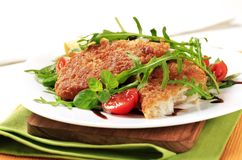 Fried fish and fresh salad Stock Photos