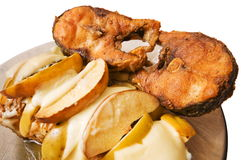 Fried fish with fruit. Fried fish a mullet with fruit and cheese Royalty Free Stock Photography