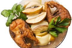 Fried fish with fruit. Fried fish a mullet with fruit and cheese Stock Image