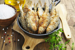 Fried fish in a frying pan Royalty Free Stock Image
