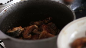 Fried fish with golden crust on a pan stock footage