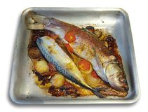 Fried fish on griddle, isolated Royalty Free Stock Image
