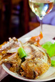 Fried fish on grill  in salt Stock Photography