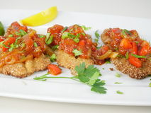 Fried fish herring with tomato sauce Royalty Free Stock Photo