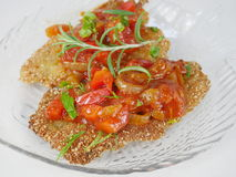 Fried fish herring with tomato sauce Stock Image
