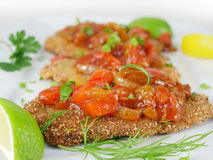 Fried fish herring with tomato sauce Stock Photo