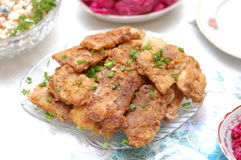 Fried fish on holiday table Stock Images