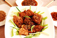 Fried fish - laos style v2. Crispy fried fish with a special ginger sauce Royalty Free Stock Images