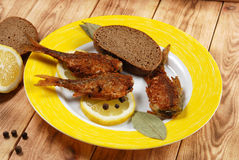 Fried fish with lemon Stock Images
