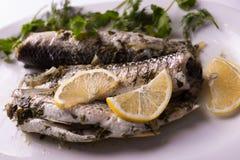 Fried fish with lemon Stock Photos