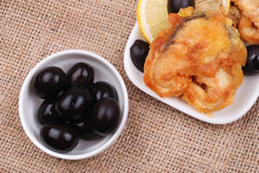 Fried fish with a lemon and olives Royalty Free Stock Image