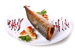 Fried fish with a lemon pieces Stock Photos