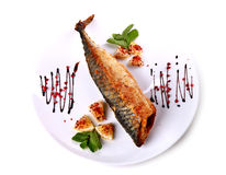 Fried fish with a lemon pieces Stock Photo