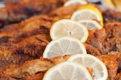 Fried fish with lemon slice Stock Photo