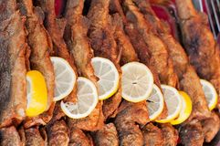 Fried fish with lemon slice Royalty Free Stock Images